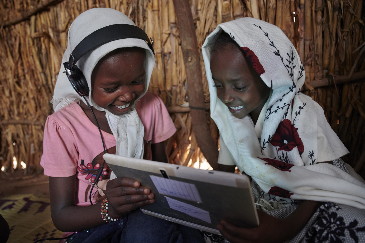 Children use their tablet and work with each other at the UNICEF supported Debate e-Learning Centre in a village on the outskirts of Kassala, the capital of the state of Kassala in Eastern Sudan.
