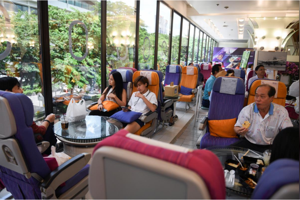 Customers eat at Thai Airways pop-up airplane-themed restaurant at the airlines headquarters with onboard meals prepared by their chefs, while their fleet is still grounded at the airport and the company awaits a bankruptcy court decision, in Bangkok, Thailand September 3, 2020.