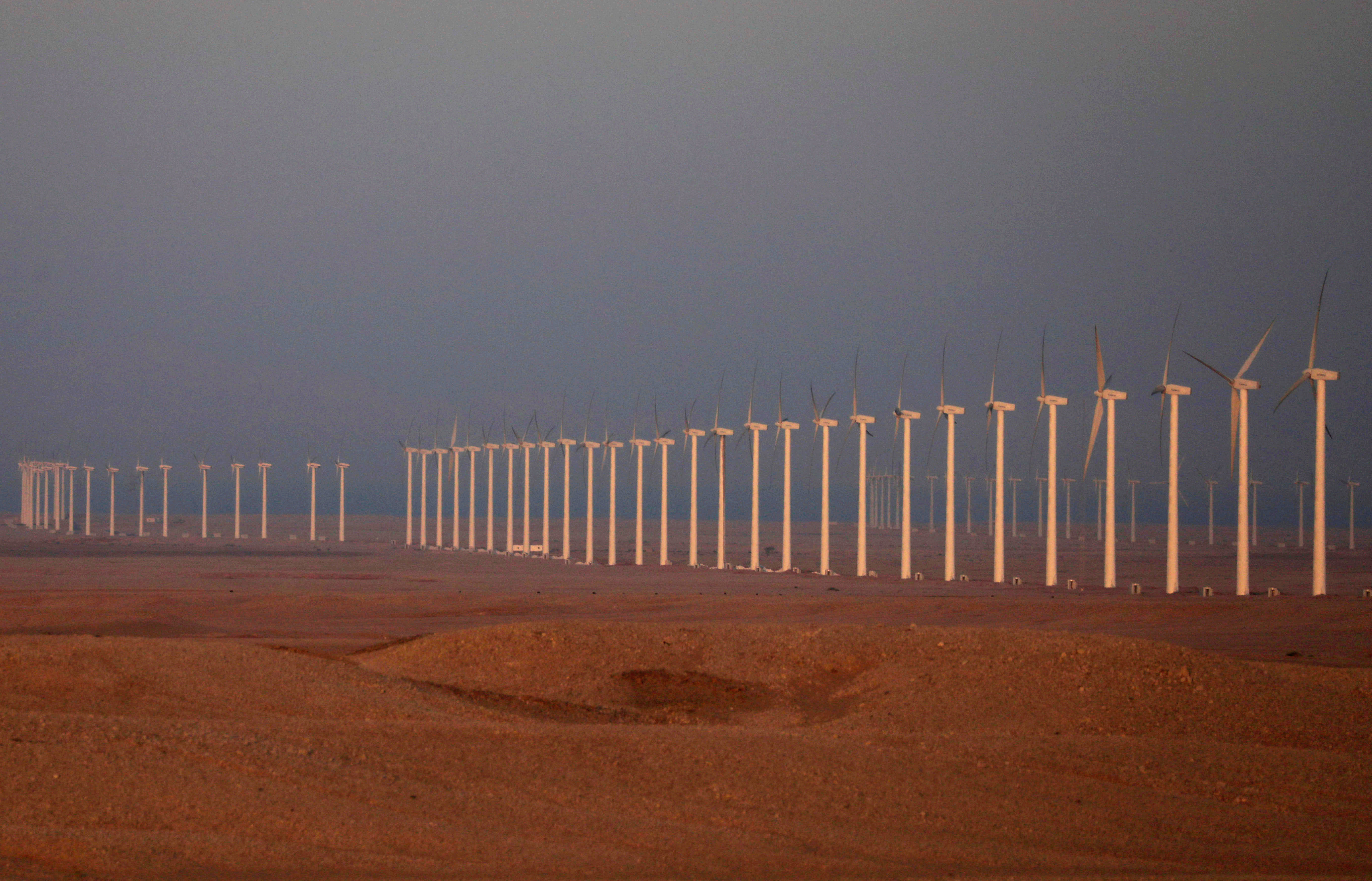 Wind turbines, which generate renewable energy, are seen on the Zafarana Wind Farm at the desert road of Suez outside of Cairo, Egypt September 1, 2020. Picture taken September 1, 2020. REUTERS/Amr Abdallah Dalsh     TPX IMAGES OF THE DAY - RC2OVI96QOYQ