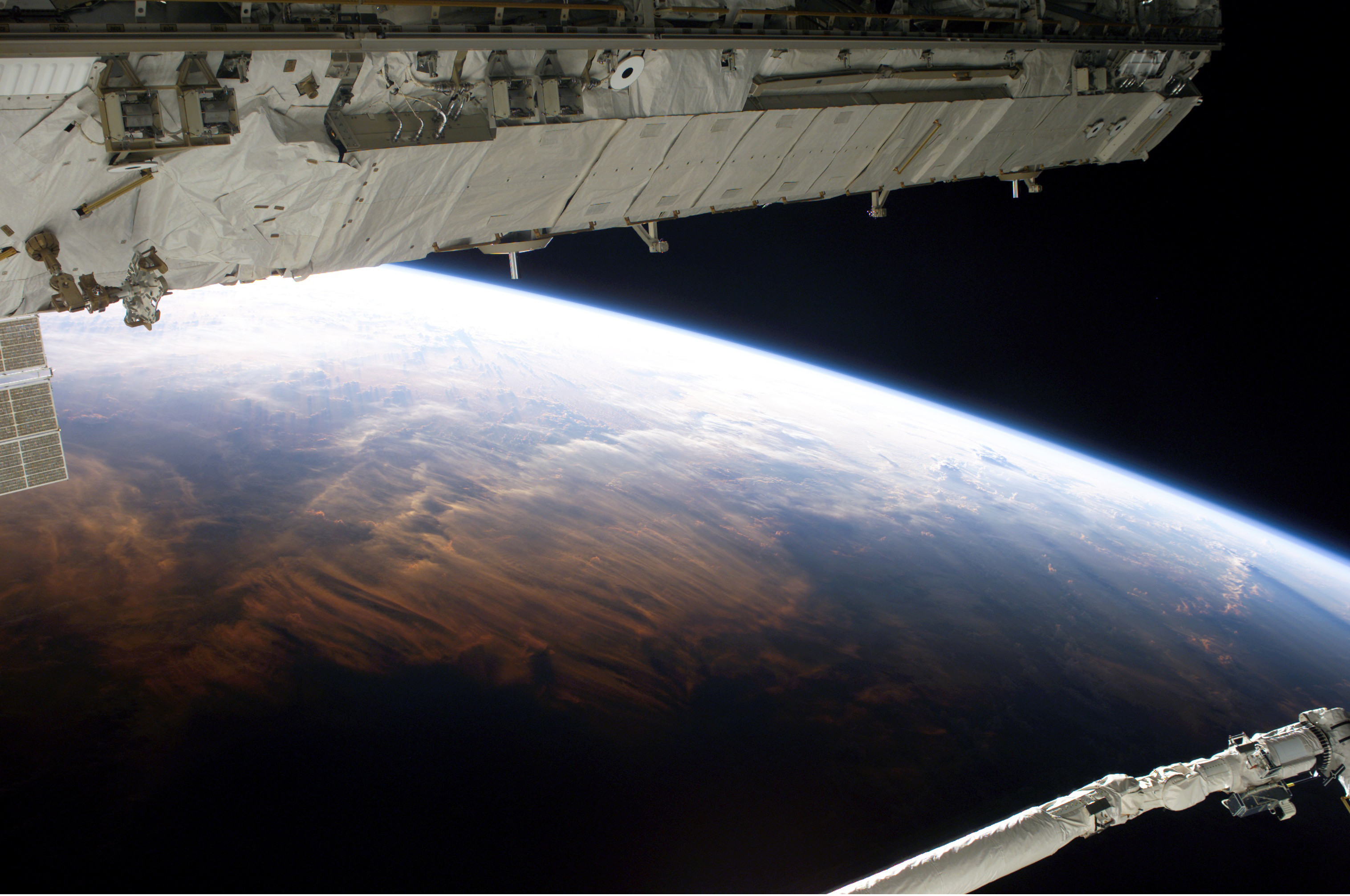 The STS-114 crew captured this view of Earth from the Shuttle-Station complex on day nine of the mission.