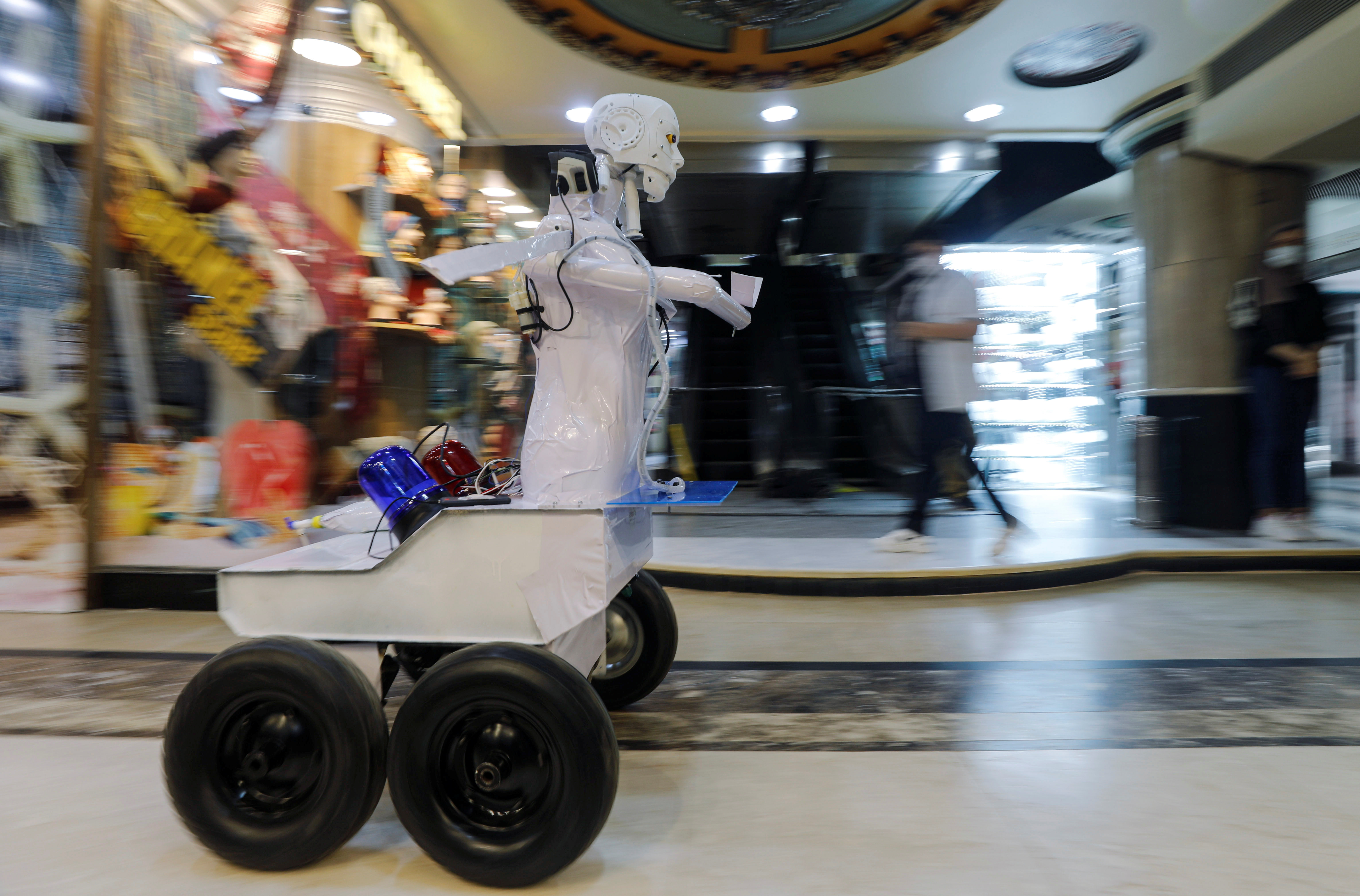 The remote-controlled robot that has been built by the Egyptian mechanical engineer, Mahmoud El komy, 26, moves at a mall to test people for the coronavirus by running PCR tests, limiting exposure to suspected cases, during the global outbreak of the coronavirus disease (COVID-19), in Cairo, Egypt June 12, 2020. Picture taken June 12, 2020.REUTERS/Mohamed Abd El Ghany - RC2U9H9YT3TT