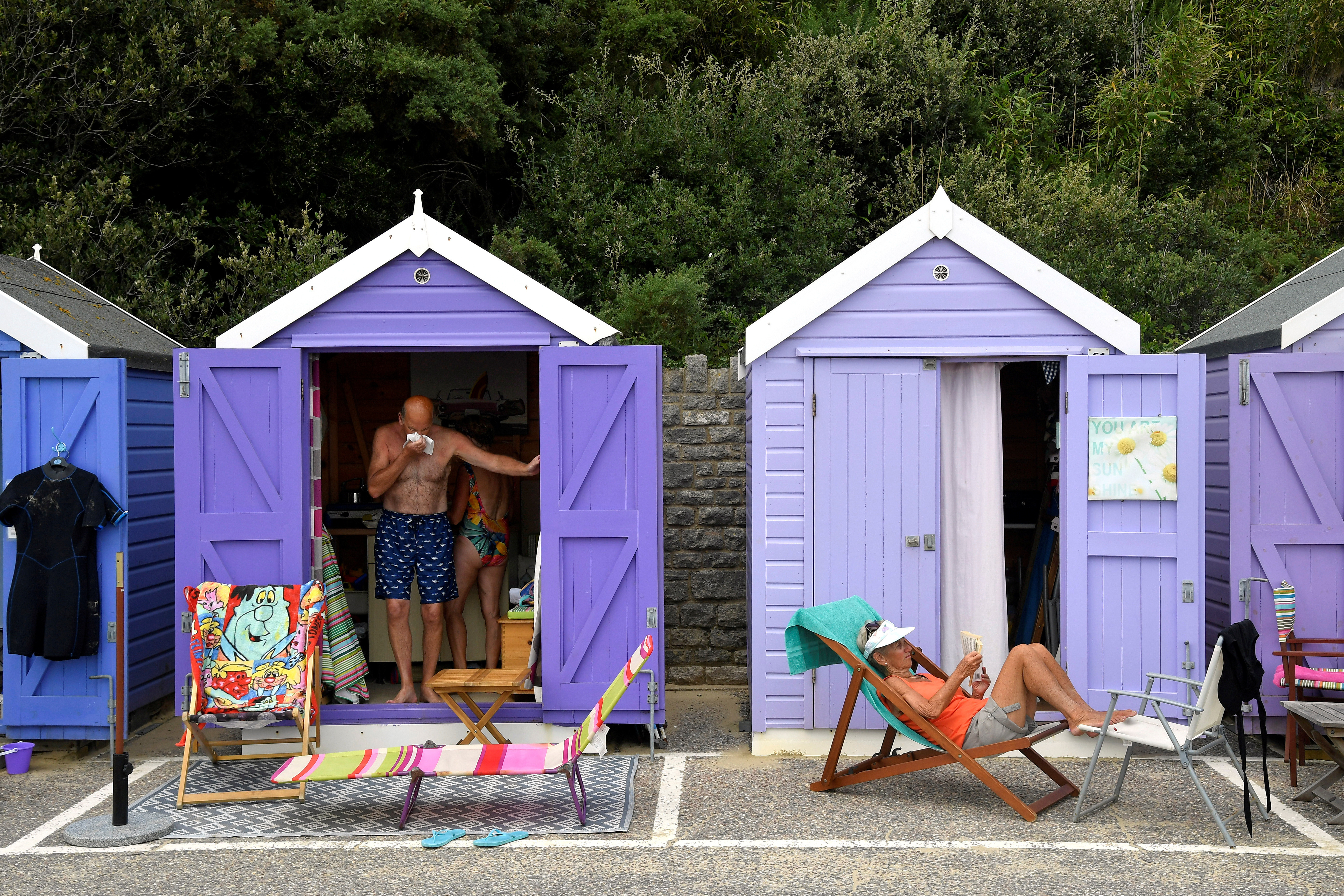 People relax as they enjoy the sunny weather at the Bournemouth Beach, amid the coronavirus disease (COVID-19) outbreak, in Bournemouth, Britain July 31, 2020. REUTERS/Toby Melville - RC2E4I9LXXK8