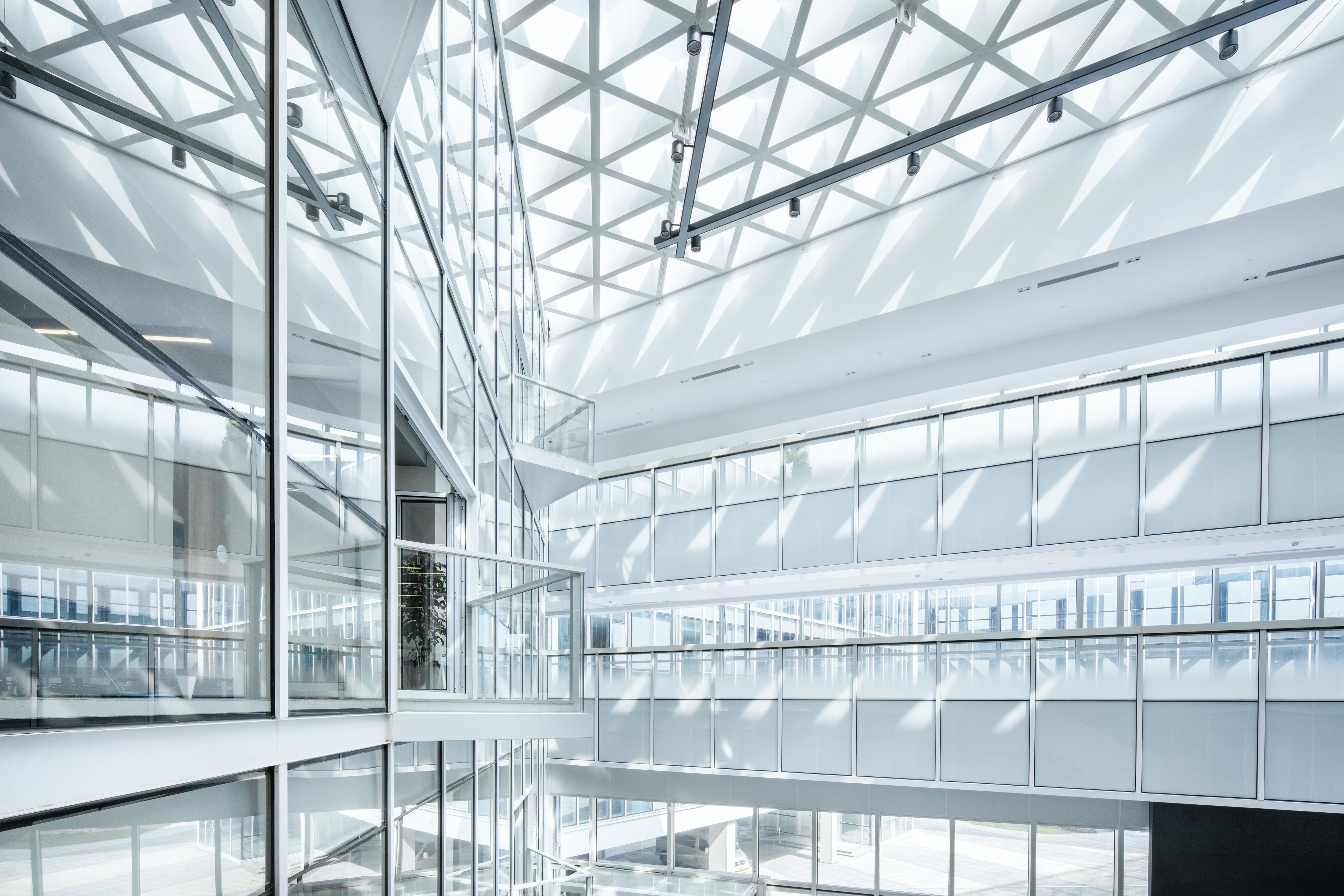 Shanghai Baoye Center by LYCS Architecture; futuristic office space; white, glass office building.