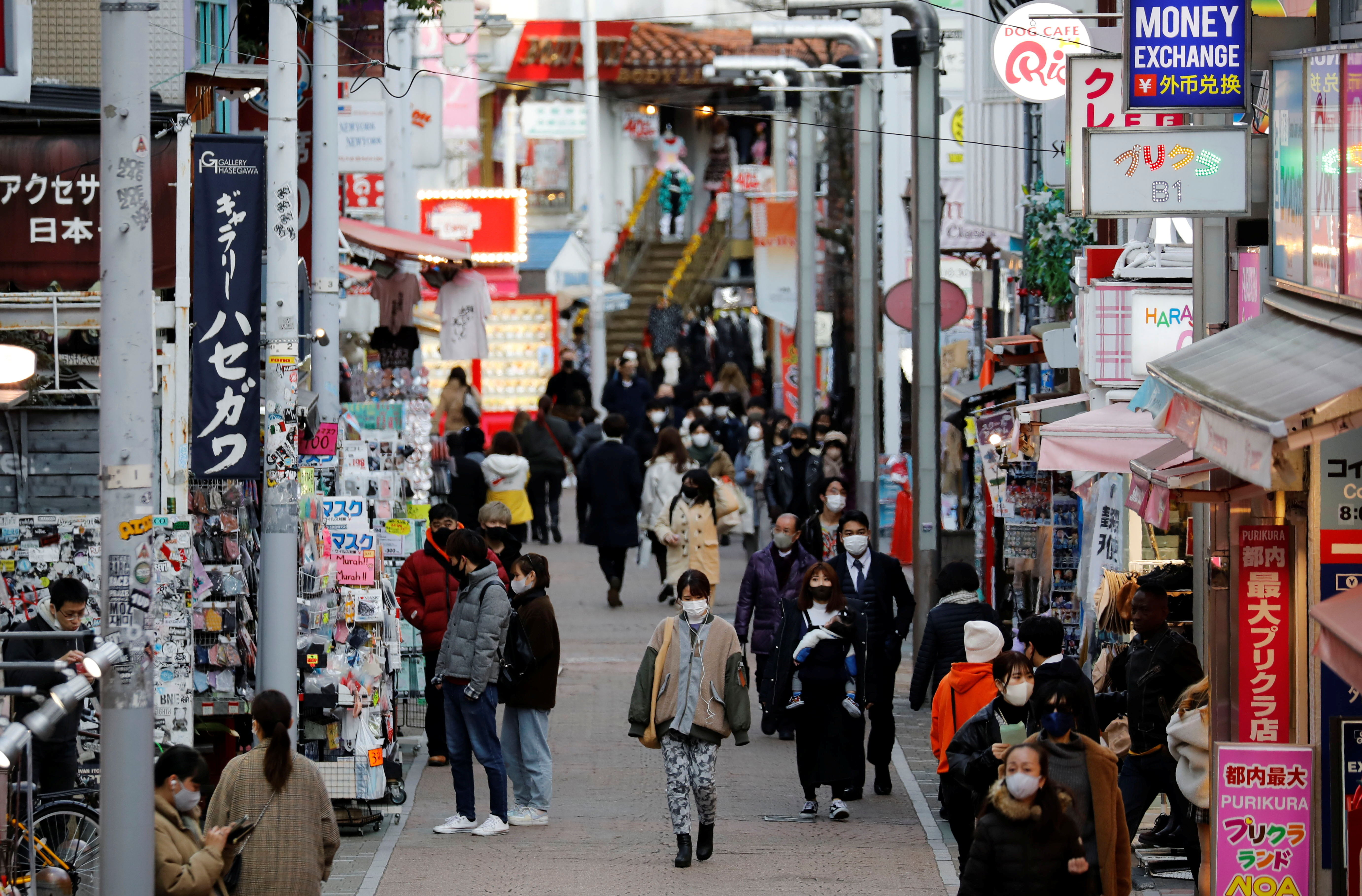 Pedestrians wearing protective masks make their way at a shopping district, amid the coronavirus disease (COVID-19) outbreak, in Tokyo, Japan, January 8, 2021. REUTERS/Kim Kyung-Hoon - RC2L3L9GEJWB