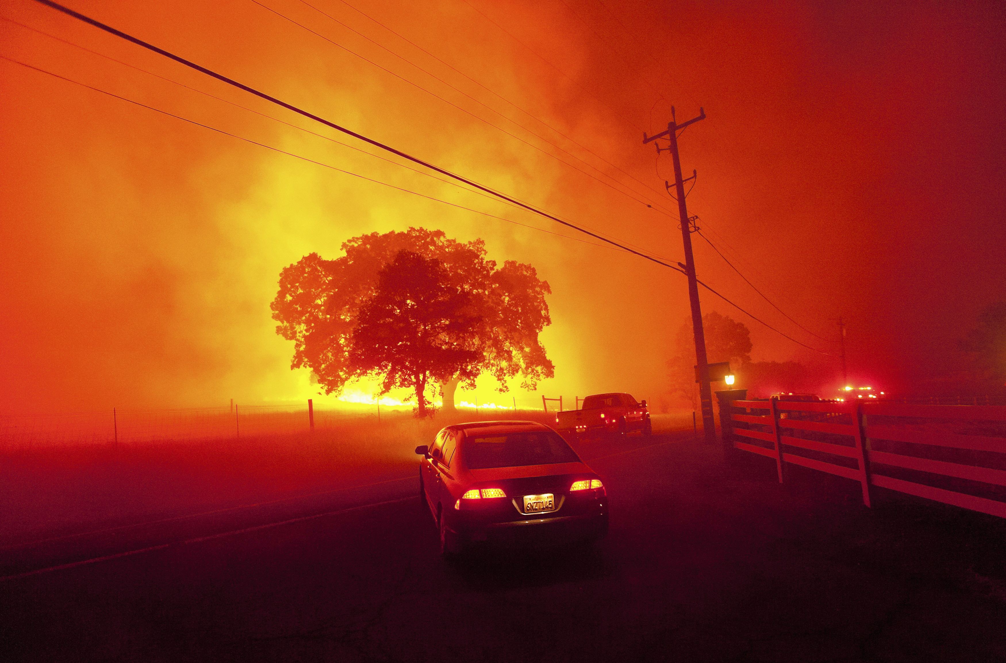 Residents flee as winds whip flames from the Morgan fire along Morgan Territory Road near Clayton, California in unincorporated Contra Costa County September 9, 2013. The blaze, burning in dense, dry scrub, grass and timber in and around Mount Diablo State Park, had scorched some 3,700 acres (1,500 hectares) by Monday afternoon, forcing the evacuation of about 100 homes at the edge of the town of Clayton. REUTERS/Noah Berger (UNITED STATES - Tags: DISASTER ENVIRONMENT SOCIETY TPX IMAGES OF THE DAY) - GM1E99A12F301