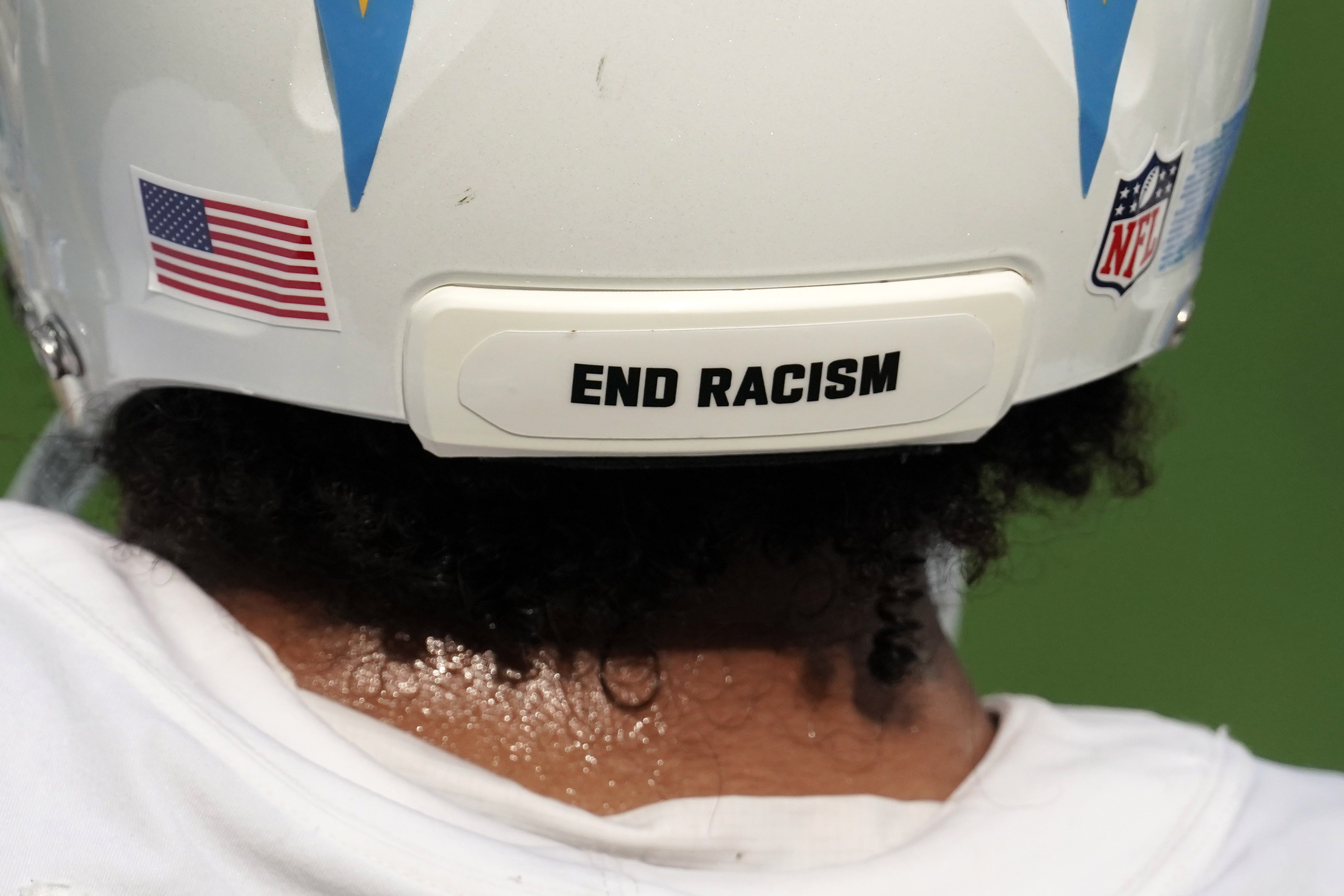 Sep 27, 2020; Inglewood, California, USA; Los Angeles Chargers linebacker Emeke Egbule (51) wears the words End Racism on the back of his helmet against the Carolina Panthers at SoFi Stadium. The Panthers defeated the Chargers 21-16. Mandatory Credit: Kirby Lee-USA TODAY Sports - 14993078