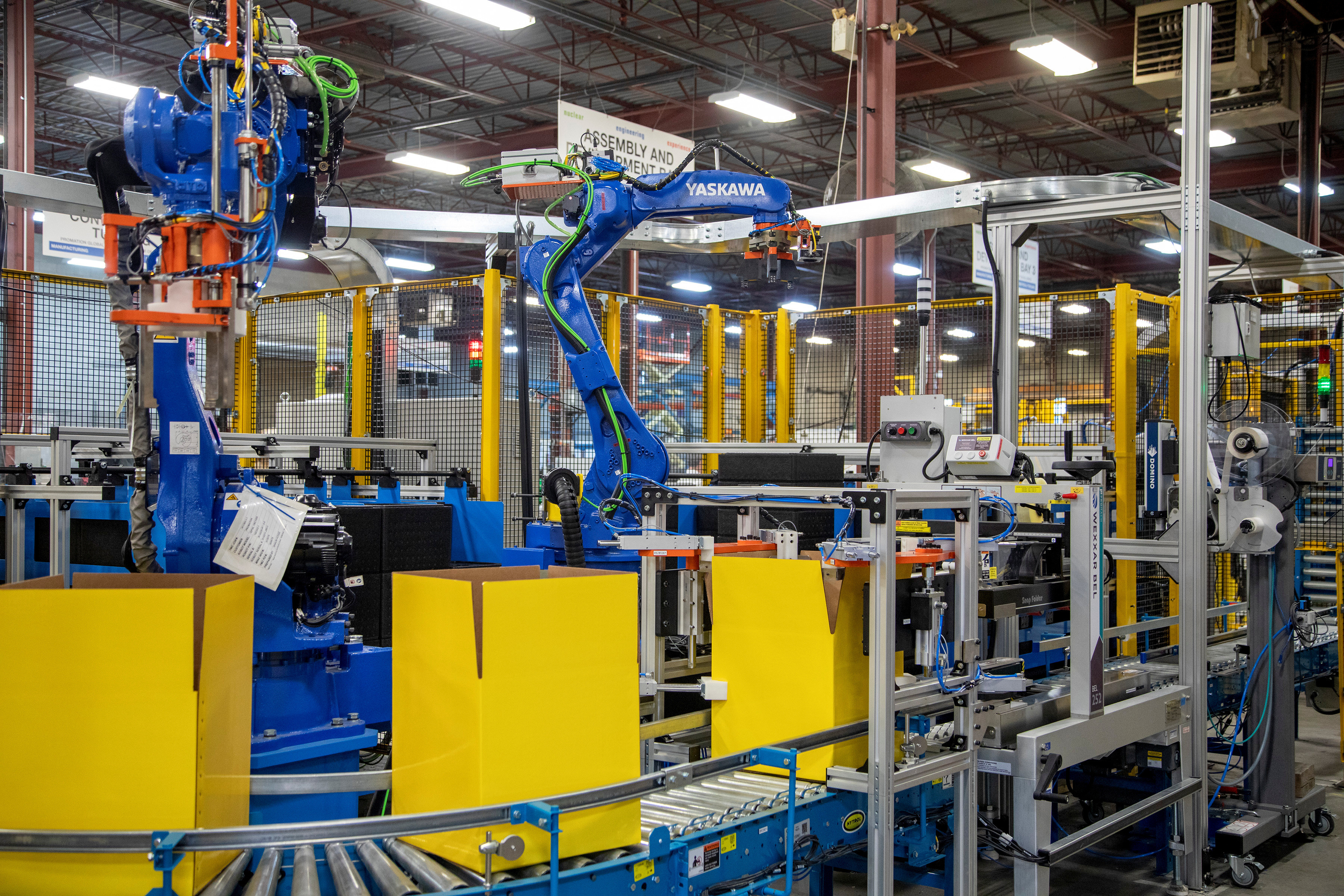 an automated packing line at Promation, a robotics engineering and automation manufacturing firm in Oakville, Ontario, Canada