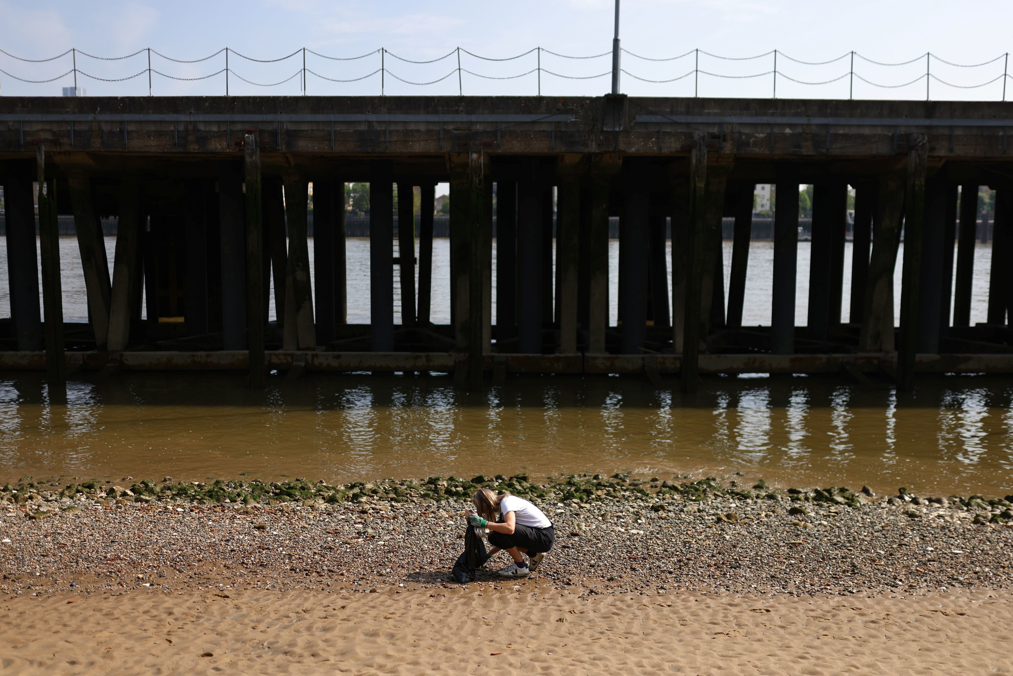 Flora Blathwayt, founder of Washed Up Cards, collects plastics found washed up on the banks of the river Thames.