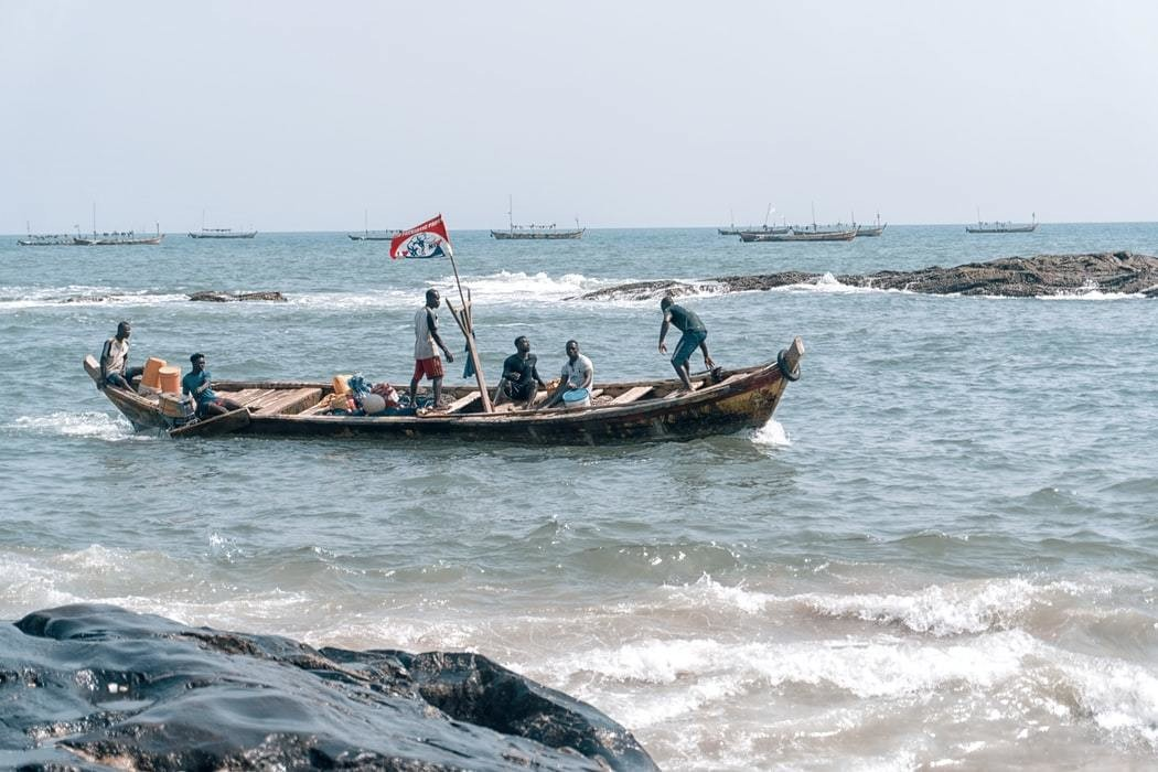 Local fishermen are seen on their boat.