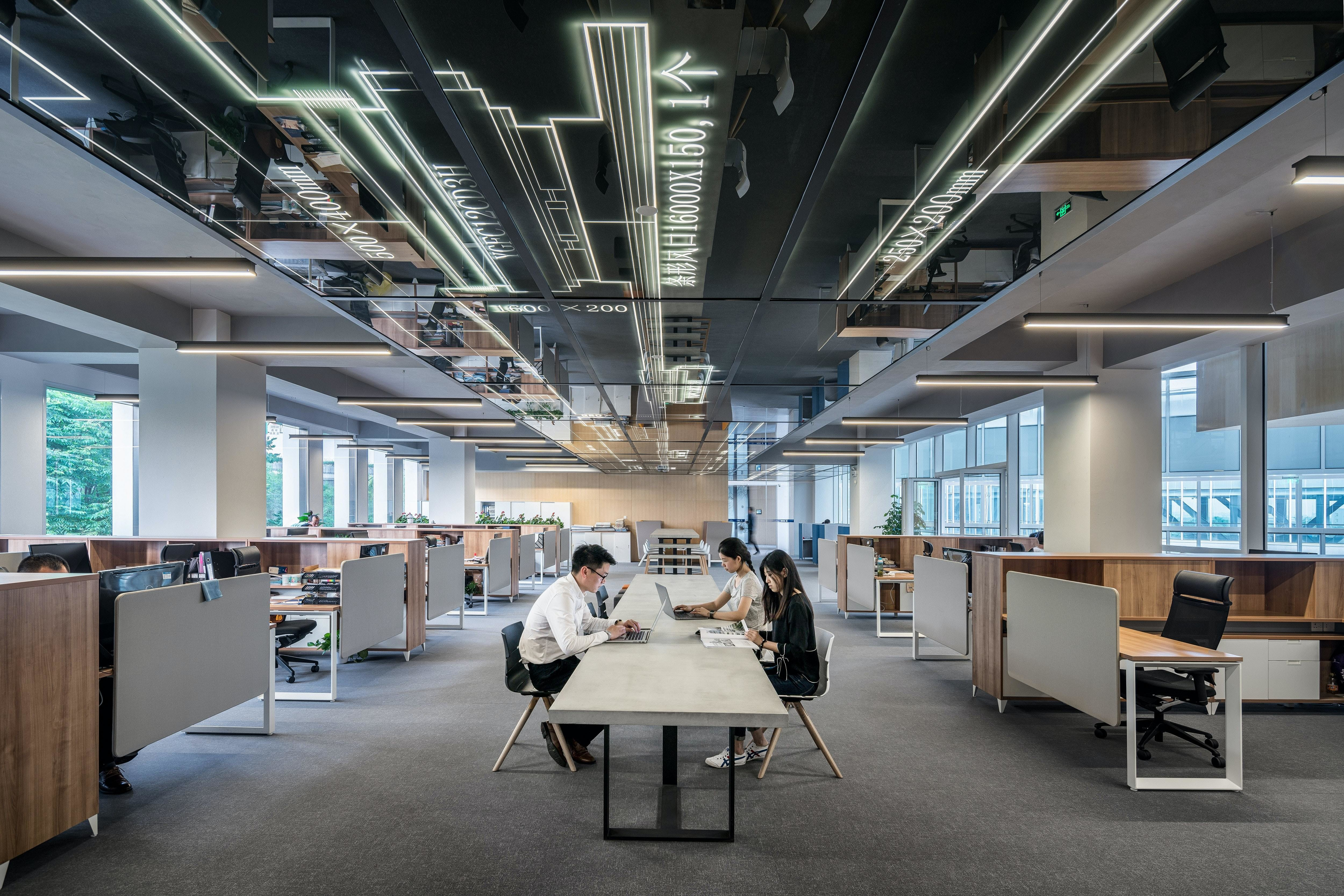 Employees sitting in an open plan modern office working