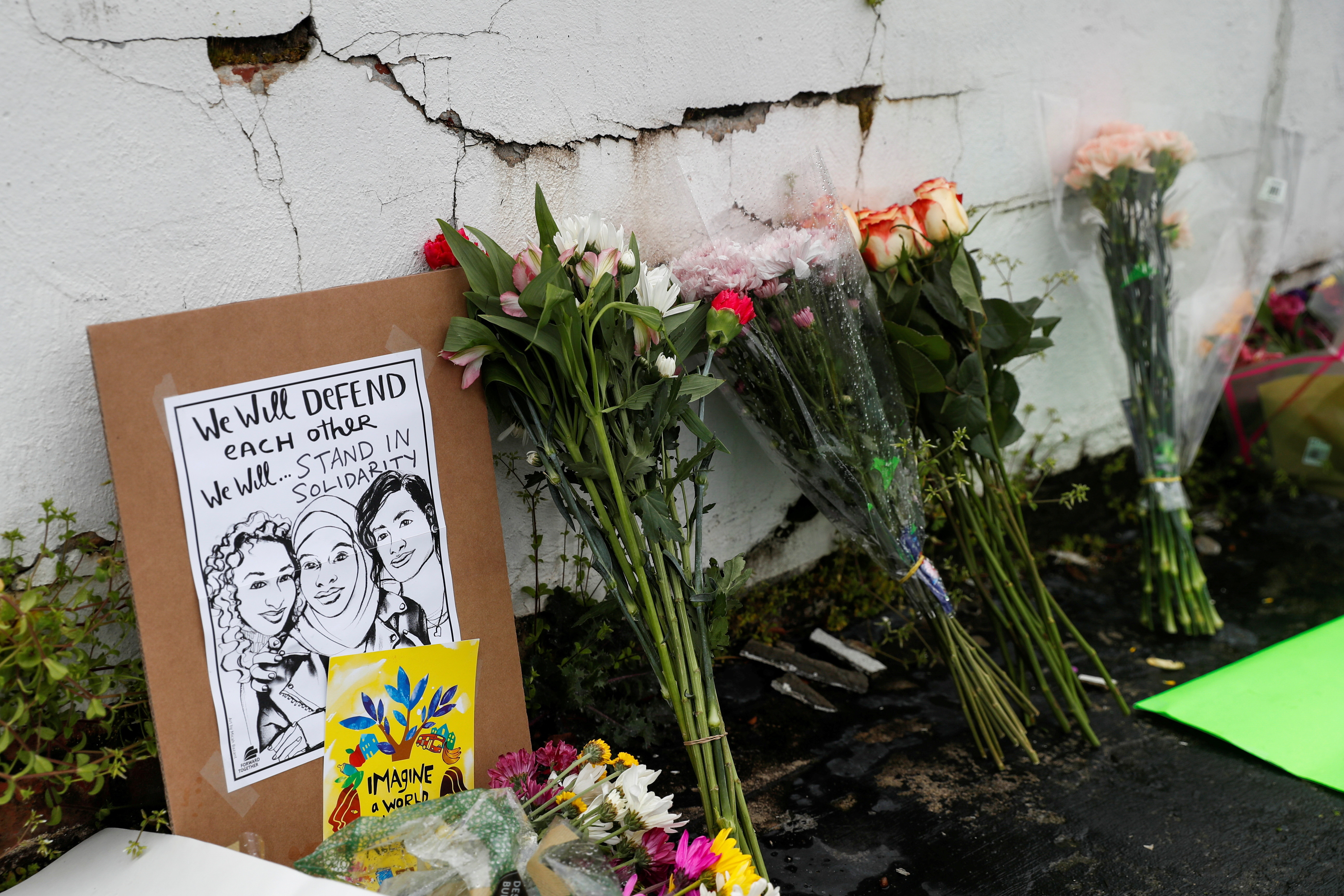 Flowers and a poster are left outside Gold Spa following the deadly shootings in Atlanta, Georgia, U.S. March 17, 2021. REUTERS/Shannon Stapleton  REFILE - CORRECTING LOCATION? - RC29DM9RL0WD