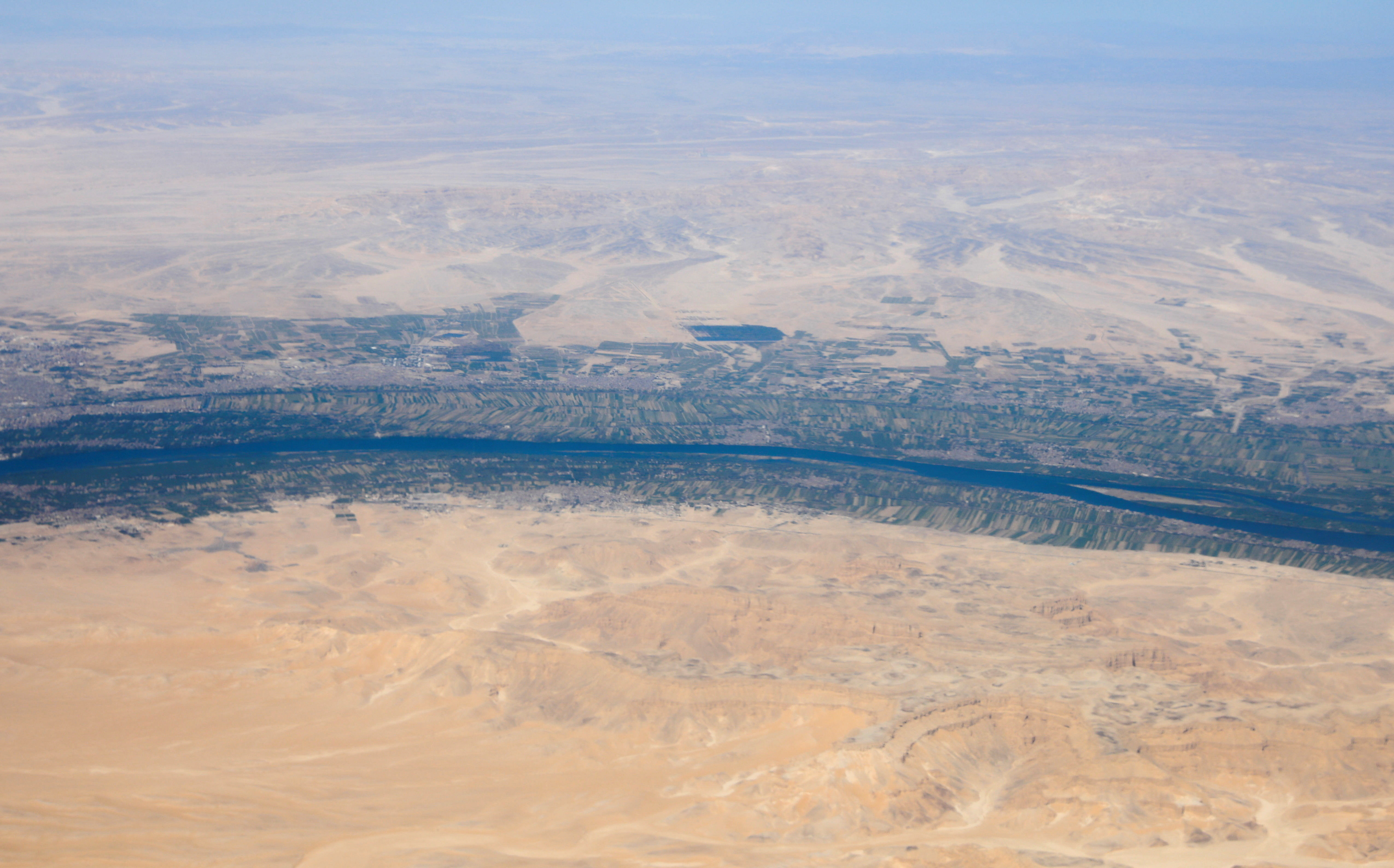 An aerial view of the River Nile valley and desert pictured through the window of an airplane on a flight between Cairo and Luxor, Egypt April 11, 2021. Picture taken April 11, 2021.