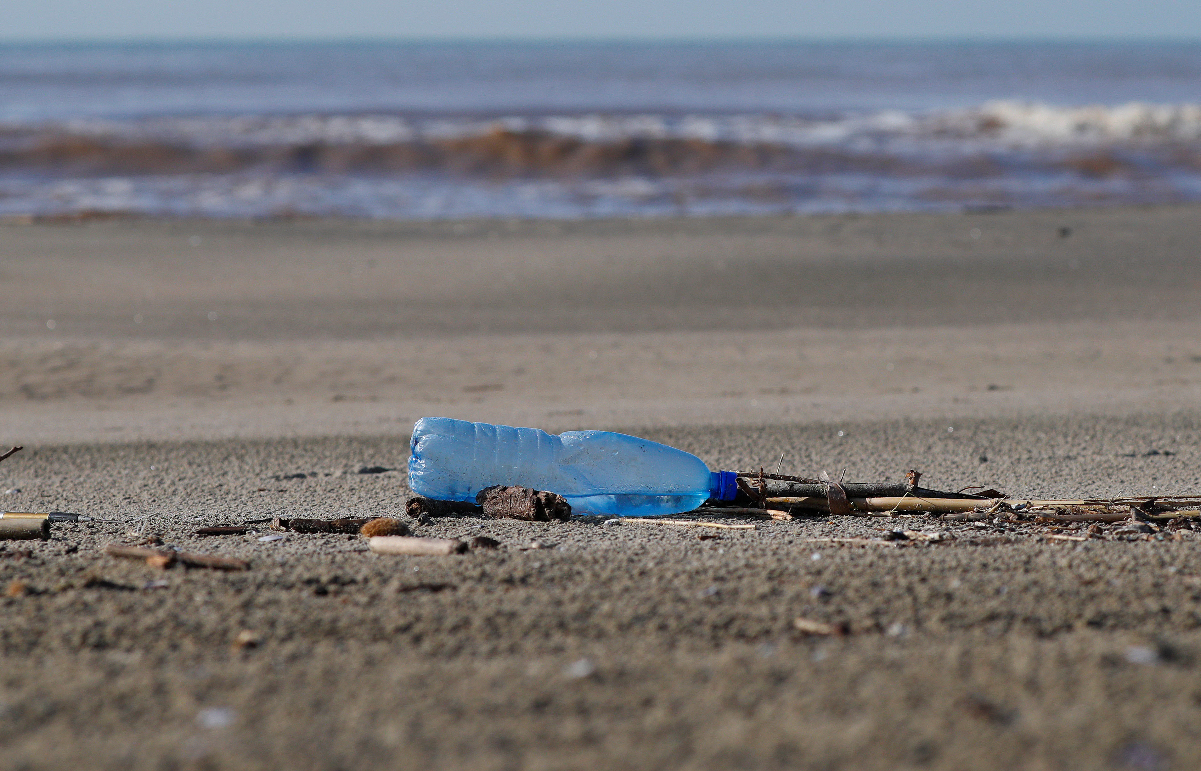 A plastic bottle lies on the sand at Maccarese beach, west of Rome, Italy. REUTERS/Max Rossi