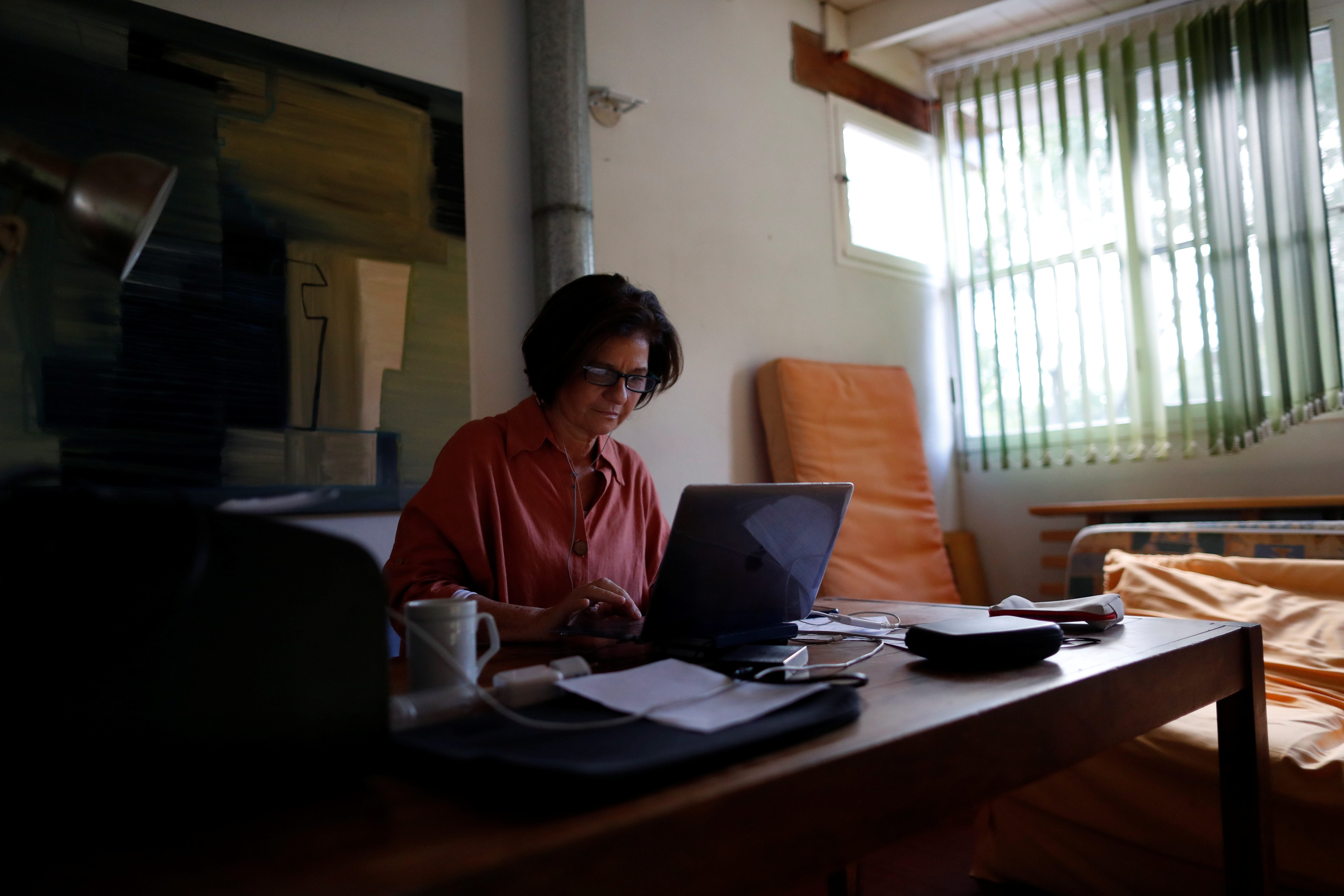 Psychoanalyst Roxana Meygide Schargorodsky works by video call with a patient, at her home in Buenos Aires, Argentina April 7, 2020. Picture taken April 7, 2020