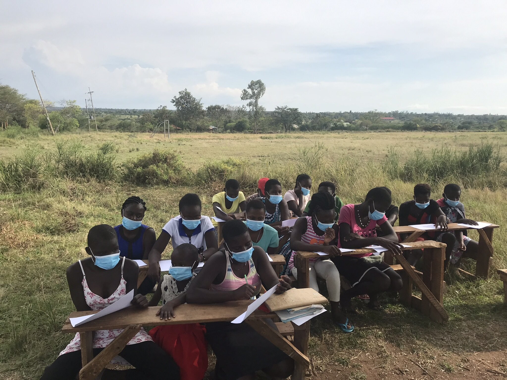Girls in Siaya, Kenya, being trained to help spread the word about masks and hand-washing
