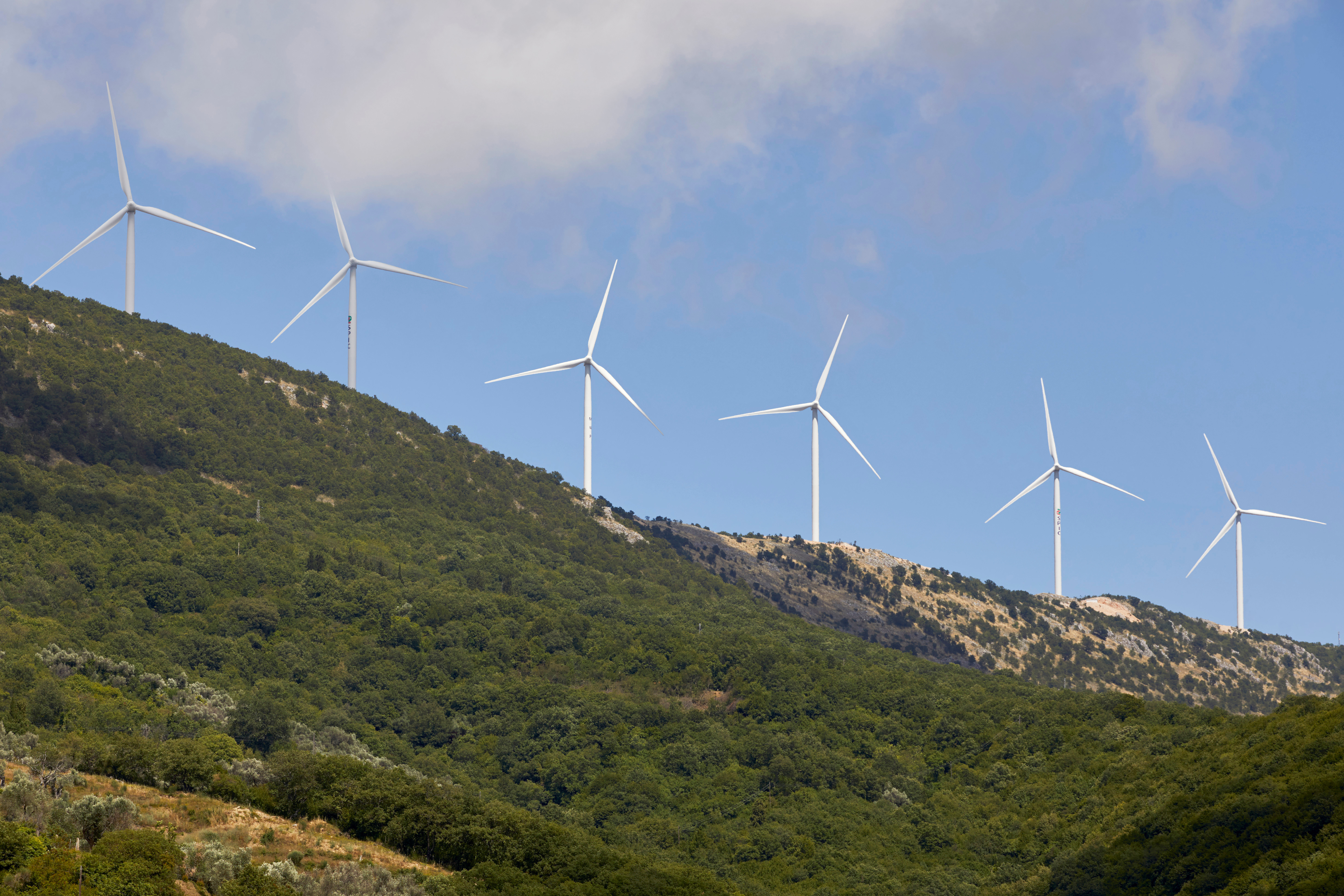 Wind turbines of the Mozura wind farm are seen in Ulcinj, Montenegro, June 18, 2020. Picture taken June 18, 2020.  REUTERS/Stevo Vasiljevic - RC29CH97XBV4