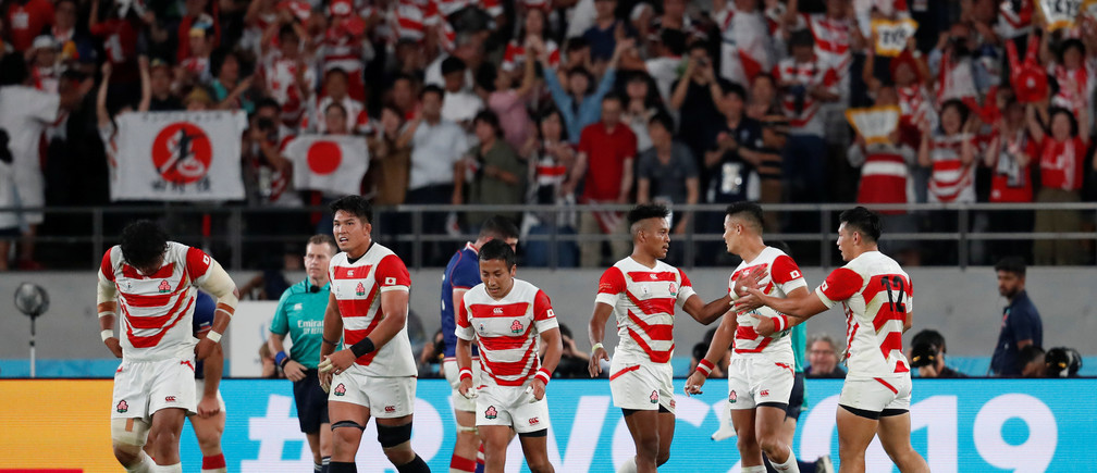 Rugby Union - Rugby World Cup 2019 - Pool A - Japan v Russia - Tokyo Stadium, Tokyo, Japan - September 20, 2019  Japan's Kotaro Matsushima celebrates scoring their second try with Ryoto Nakamura and team mates  REUTERS/Matthew Childs - RC1919927140
