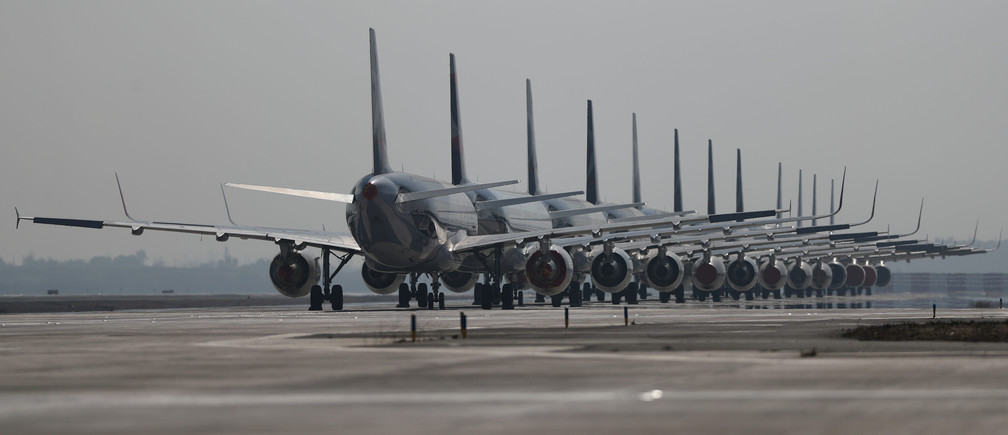 Passenger planes parked on a runway are seen during a general quarantine amid the spread of the coronavirus disease (COVID-19), at the Arturo Merino Benitez International Airport, in Santiago, Chile May 26, 2020.