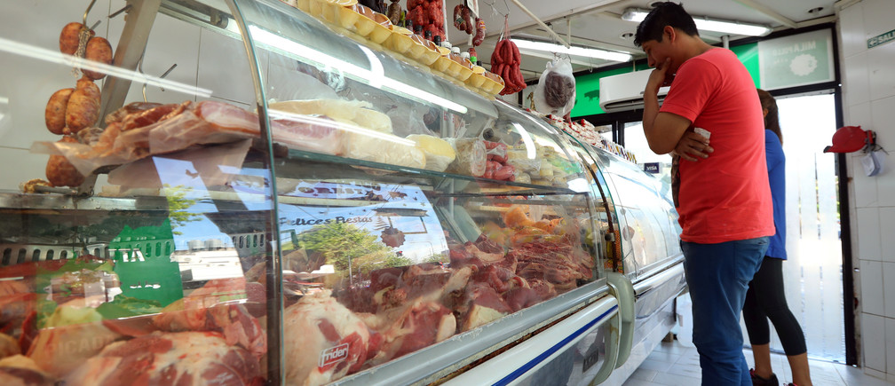 A man looks at meat on display inside a butcher shop in Buenos Aires, Argentina October 29, 2018. Picture taken October 29, 2018. REUTERS/Marcos Brindicci - RC1A92DD1360