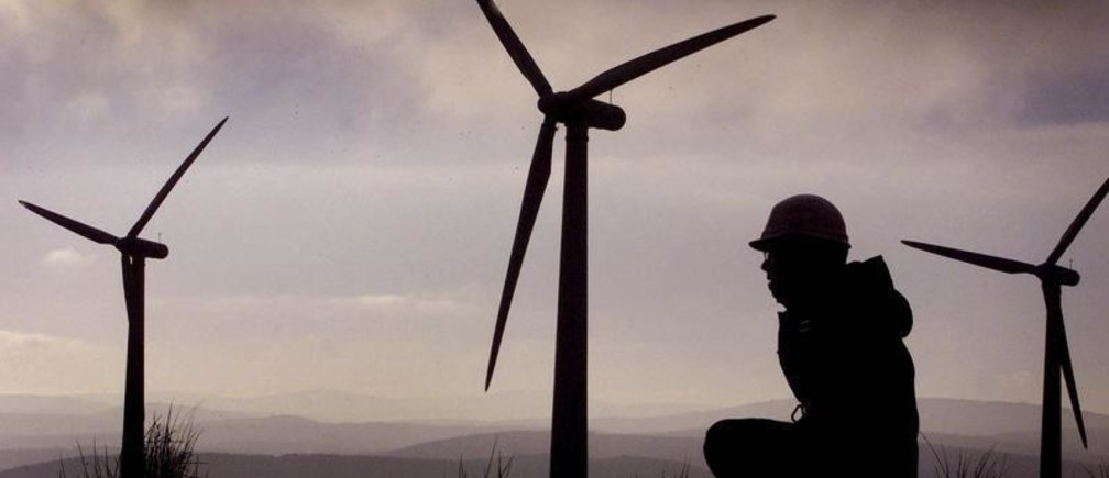 An engineer from renewable energy company  Ingenco monitors the Scottish Power windfarm at Hagshaw Hill near Douglas in Scotland December 13, 2001. Plans for the construction of what is being described as the world's biggest wind farm are being unveiled later today.  The plans will see the construction of 250 huge turbines on the[ Hebridean island of Lewis off the west coast of Scotland.] - PBEAHUKVQBX