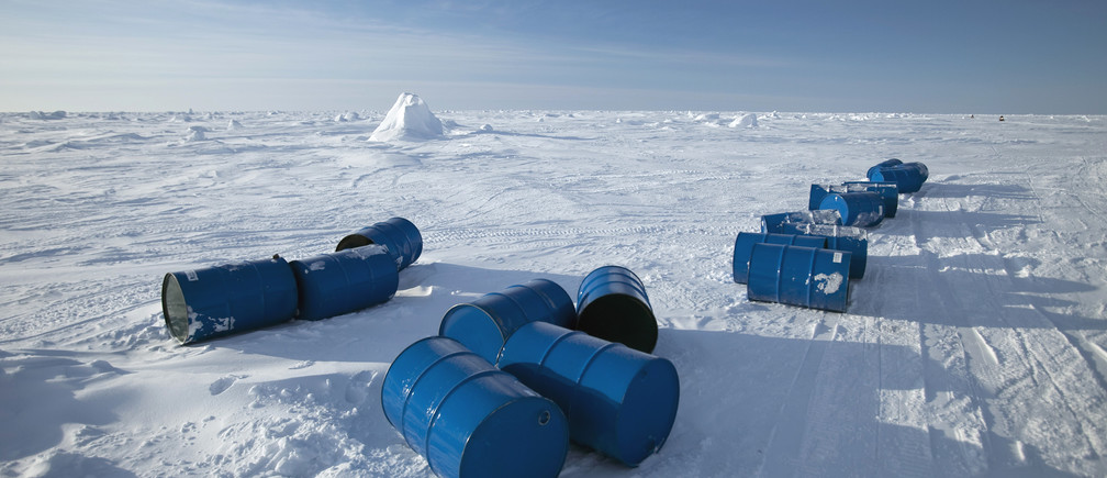 Fuel drums are seen on Arctic ice near the 2011 Applied Physics Laboratory Ice Station north of Prudhoe Bay, Alaska March 18, 2011. Picture taken March 18, 2011.  REUTERS/Lucas Jackson (UNITED STATES - Tags: ENVIRONMENT) - GM1E73O13FG01
