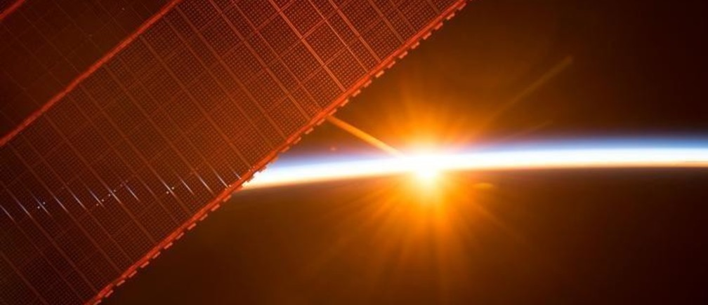 A photo taken on July 26, 2017 by a member of the Expedition 52 crew aboard the International Space Station shows one of the 16 sunrises they experience every day, as the orbiting laboratory travels around Earth. One of the solar panels that provides power to the station is seen in the upper left. NASA/Handout via REUTERS    ATTENTION EDITORS - THIS IMAGE WAS PROVIDED BY A THIRD PARTY