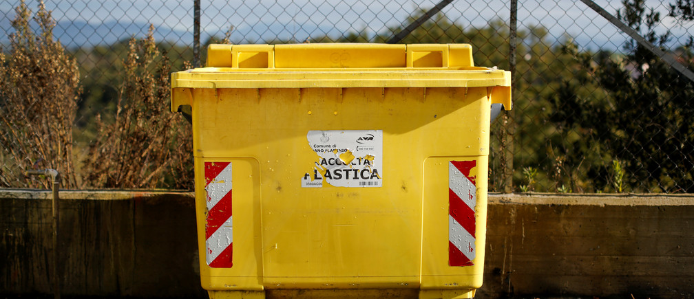 A plastic recycling dumpster is seen in a parking lot in Riano Flaminio, near Rome, Italy November 21, 2018. REUTERS/Tony Gentile - RC1826FD1580