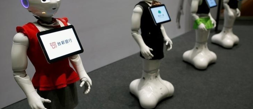 SoftBank's robots 'pepper', dressed in different bank uniforms, are displayed during a news conference in Taipei, Taiwan July 25, 2016