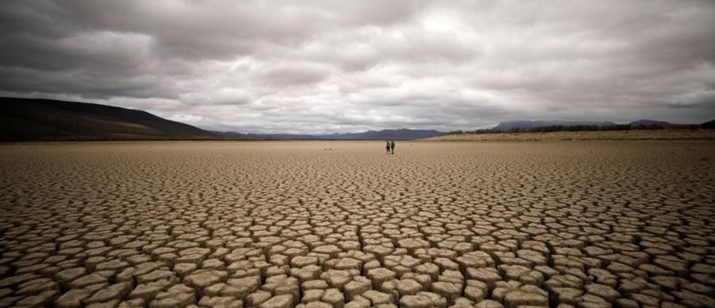 Clouds gather but produce no rain as cracks are seen in the dried up municipal dam in drought-stricken Graaff-Reinet, South Africa, November 14, 2019. Picture taken November 14, 2019.  REUTERS/Mike Hutchings - RC2WKD968B79