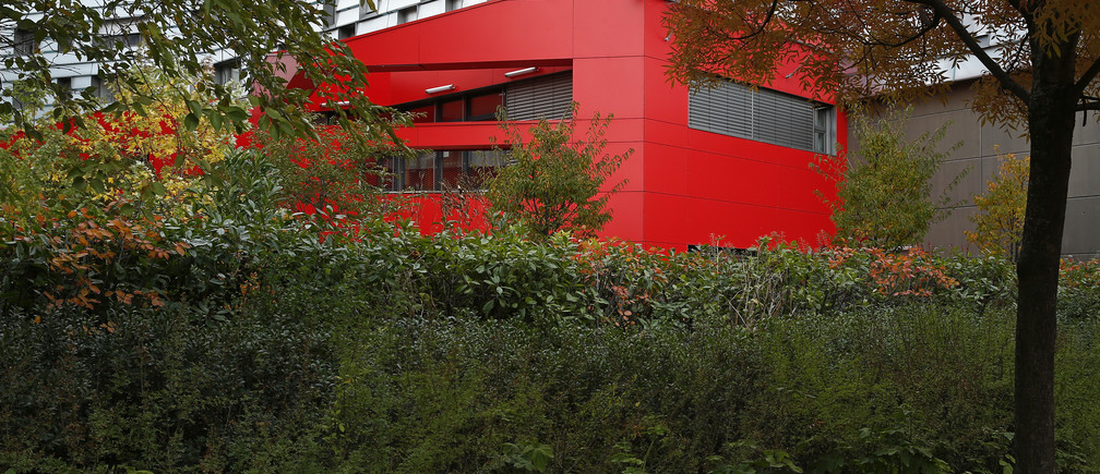 "Trees and plants frame a building in the ""eco-neighbourhood"", Clichy-Batignolles, one of several new ecological housing developments with low energy use and carbon emissions, in Paris, France, October 22, 2015. The city of Paris presented its latest ""eco-neighbourhood"" ahead of the COP21, the World Climate Summit from November 30 to December 11, 2015.   REUTERS/Benoit Tessier"