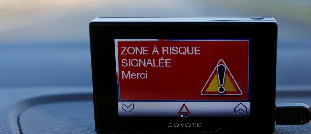 A Coyote system is seen in a vehicle as it provides real-time information on speed limits, dangers locations, traffic hazards and traffic conditions along the A62 motorway in Toulouse December 31, 2014.