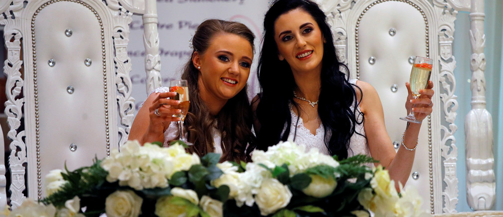 Sharni Edwards, 27, and Robyn Peoples, 26, a Belfast couple who are the first known same-sex couple to get married in Northern Ireland, pose after being married, in Carrickfergus, Northern Ireland February 11, 2020. REUTERS/Phil Noble - RC2EYE9DL2VG
