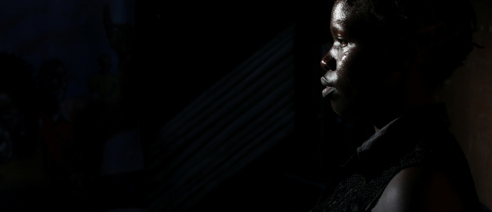 """Irene Lasu, 26, a spoken word poet and member of Ana Taban, poses for a photograph in Juba, South Sudan, April 23rd, 2017. REUTERS/Andreea Campeanu  SEARCH """"CAMPEANU ANA TABAN"""" FOR THIS STORY. SEARCH """"WIDER IMAGE"""" FOR ALL STORIES. TPX IMAGES OF THE DAY. - RTX3B3NS"""