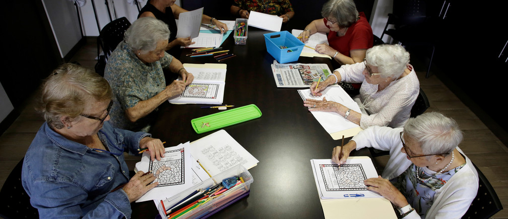 Elderly women take part in a mental therapy class in the Verdeza building complex for seniors, in San Jose, Costa Rica October 15, 2018. REUTERS/Juan Carlos Ulate - RC1A12459A00