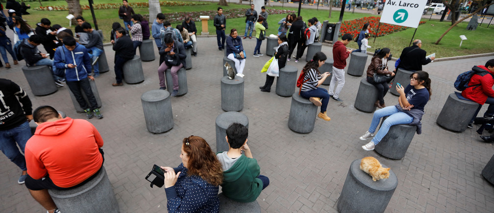 "People play the augmented reality mobile game ""Pokemon Go"" at Kennedy park in Lima, Peru, August 6, 2016."