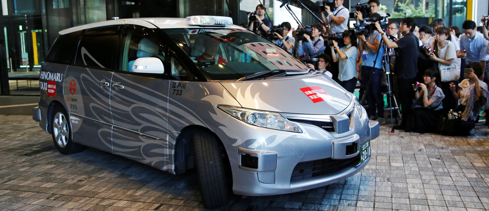 ZMP Inc's RoboCar MiniVan, a self-driving taxi based on a Toyota Estima Hybrid car, operated by Hinomaru Kotsu Co, is seen at the start of its services proving test in Tokyo, Japan August 27, 2018.