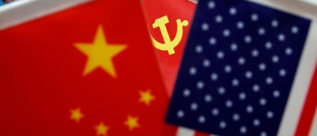 The flags of China, U.S. and the Chinese Communist Party are displayed in a flag stall at the Yiwu Wholesale Market in Yiwu, Zhejiang province, China, May 10, 2019. REUTERS/Aly Song - RC16D2FCA740