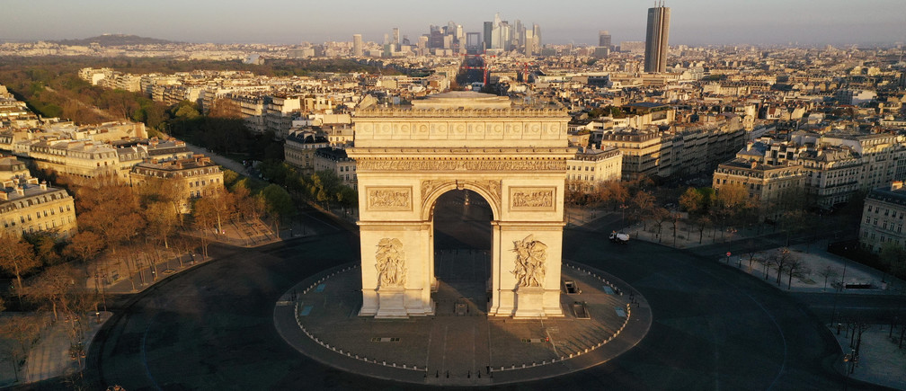An aerial view shows the deserted Place de l'Etoile and the Arc de Triomphe, during a lockdown imposed to slow the spread of the coronavirus disease (COVID-19) in Paris, France April 4, 2020. Picture taken with a drone.