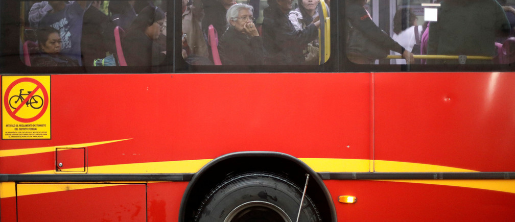 An elderly woman is pictured inside a bus on a rainy day in Mexico City, Mexico, June 29, 2017. Picture taken June 29, 2017. REUTERS/Edgard Garrido - RC191AF49BB0