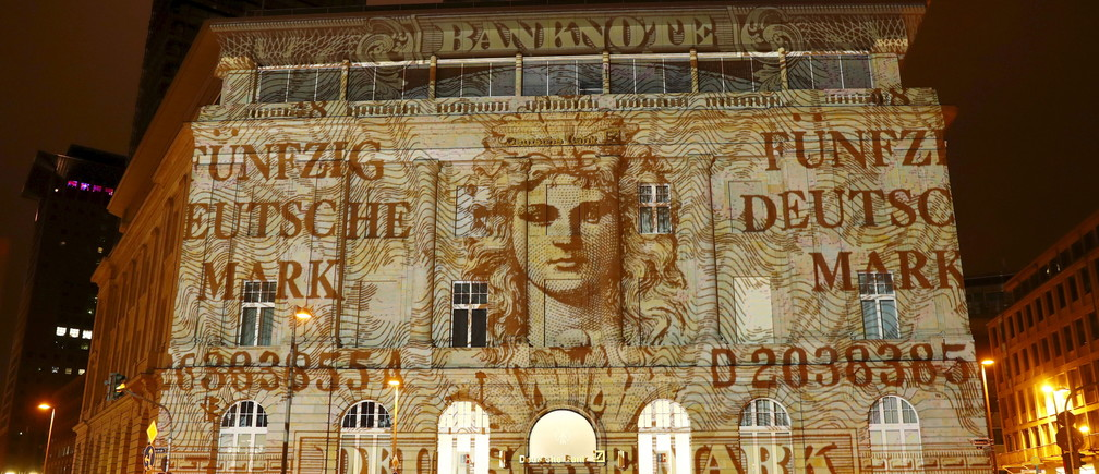 """A branch of Germany's largest business bank, Deutsche Bank AG, is illuminated with a banknote of Germany's former currency, Deutsche Mark, at the start of the """"Luminale, light and building"""" event in Frankfurt, Germany, March 12, 2016. REUTERS/Kai Pfaffenbach  - GF10000343235"""