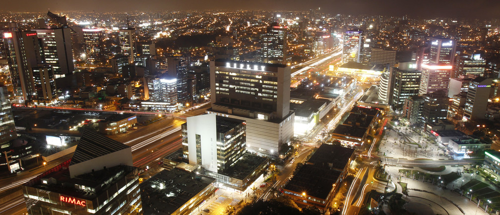 The financial center of San Isidro's district is seen from the top of a building in Lima, December 19, 2013. REUTERS/Enrique Castro-Mendivil (PERU - Tags: SOCIETY CITYSCAPE BUSINESS) - RTX16P4J