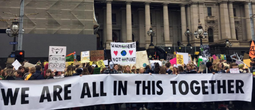 People at a rally organised by Extinction Rebellion in Melbourne, Australia.