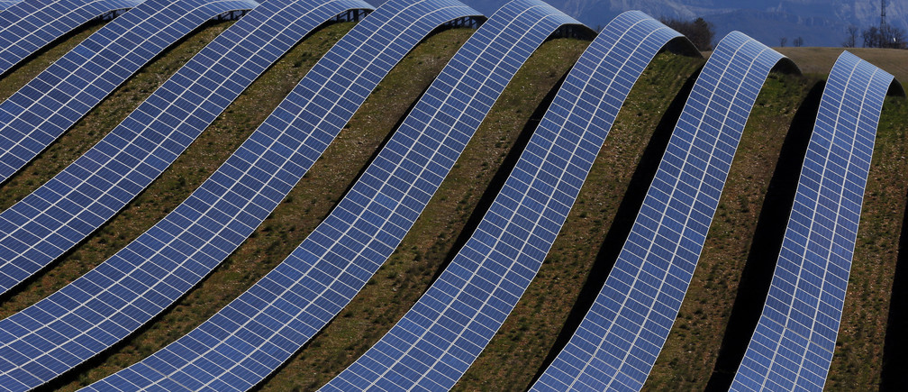 A general view shows solar panels to produce renewable energy at the photovoltaic park in Les Mees, in the department of Alpes-de-Haute-Provence, southern France March 31, 2015. The solar farm of the Colle des Mees, the biggest in France, consists of 112,780 solar modules covering an area of 200 hectares of land and representing 100 MW of power.    REUTERS/Jean-Paul Pelissier - PM1EB3V182301
