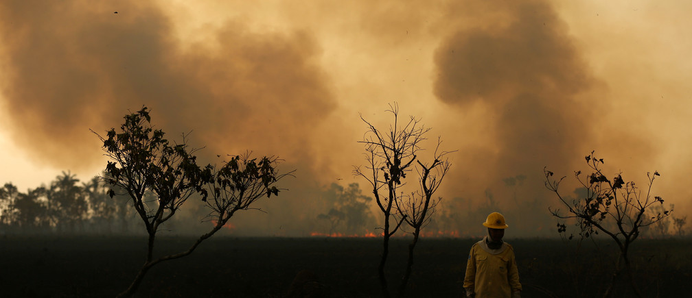 A Brazilian Institute for the Environment and Renewable Natural Resources (IBAMA) fire brigade member is seen as he attempts to control hot points during a fire at Tenharim Marmelos Indigenous Land, Amazonas state, Brazil, September 15, 2019. Picture taken September 15, 2019. REUTERS/Bruno Kelly     TPX IMAGES OF THE DAY - RC19585F4790