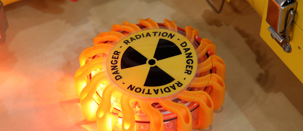 A radioactivity symbol is pictured at the World Nuclear Exhibition (WNE), the trade fair event for the global nuclear community in Villepinte near Paris, France, June 26, 2018. REUTERS/Benoit Tessier - RC16BE90D2C0