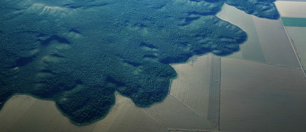 The Amazon rainforest next to converted farmland near the city of Alta Floresta, Para state, Brazil.