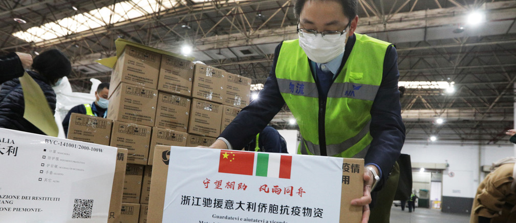 Staff members move medical supplies to be sent to Italy for the prevention of the novel coronavirus, following the coronavirus outbreak, at a logistics center of the international airport in Hangzhou, Zhejiang province, China March 10, 2020.  Picture taken March 10, 2020. China Daily via REUTERS ATTENTION EDITORS - THIS IMAGE WAS PROVIDED BY A THIRD PARTY. CHINA OUT. - RC27IF9T61PM