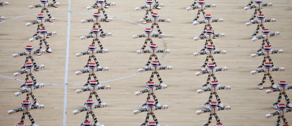 Robots perform dancing during a robot contest in Dezhou, Shandong province, China August 21, 2017.
