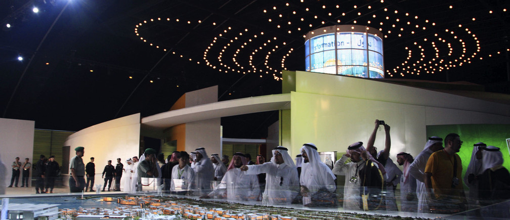 Visitors look at a model of King Abdullah University of Science and Technology (KAUST) displayed at the opening ceremony of the university in Jeddah September 23, 2009.