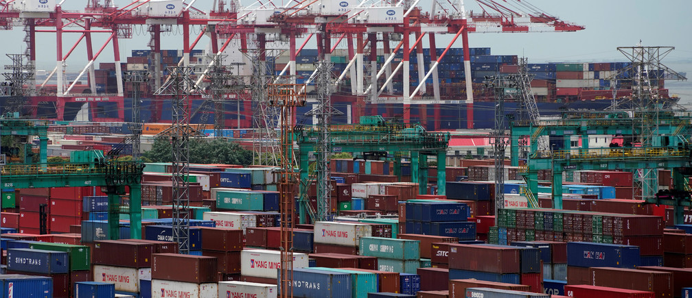 Shipping containers are seen at a port in Shanghai, China July 10, 2018. REUTERS/Aly Song - RC11AE1615D0